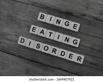 Binge Eating Disorder, word cube with background.