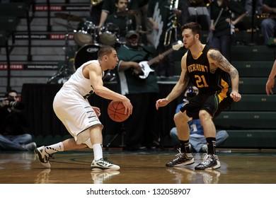 BINGHAMTON, NY-  FEBRUARY 28: Binghamton's Jimmy Gray dribbles the basketball against Vermont at the Events Center February 28, 2013 in Binghamton, NY