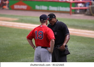 BINGHAMTON, NY - JULY 7: Portland Sea Dogs manager Kevin Boles has a discussion with the umpire in a game against the Binghamton Mets at NYSEG Stadium on July 7, 2011 in Binghamton, NY