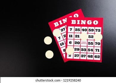 Bingo cards on black background.