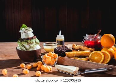 Bingsu or Bingsoo Korean shaved ice dessert with sweet toppings-Green Tea , popular dessert.