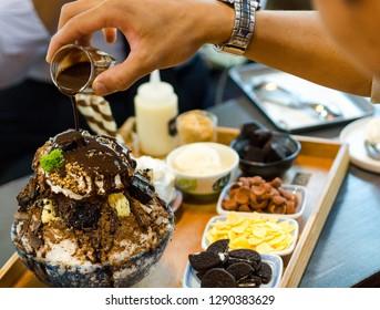 Bingsu or Bingsoo Korean shaved ice dessert with sweet toppings - chocolate bingsoo