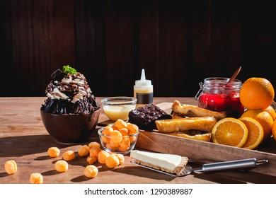 Bingsu or Bingsoo Korean shaved ice dessert with sweet toppings and fruit and varieties with ingredients, popular dessert-image