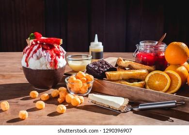 Bingsu or Bingsoo  Korean shaved ice dessert with sweet toppings and fruit and varieties with ingredients, popular dessert.