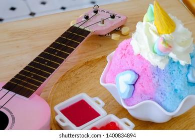 Bingsu unicorn with marshmallow at the side of ukulele.