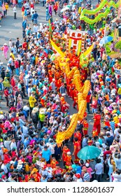 Binh Duong, Vietnam - March 2nd, 2018: Lantern Festival with colorful dragons marched show in streets attracted surrounding crowd. This traditional festivals of ethnic Chinese in Binh Duong, Vietnam