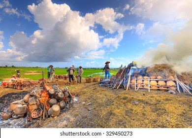 Binh Thuan province, Vietnam - October 12, 2015:traditional pottery village, the handicraftsmen burn products, which are made by their hands in the traditional way  with wood and rice straw  outdoors