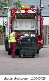 a binman dumping the rubbish