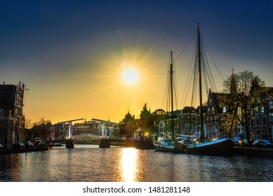 The Binnen Spaarne Canal Running through Haarlem, the Netherlands, with the Famous Gravestenenbrug, in the Afternoon Sun