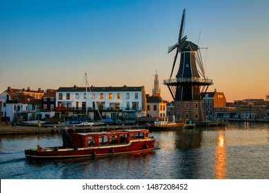 The Binnen Spaarne Canal Running through Haarlem, the Netherlands, with the Famous Windmill De Adraan, in the Afternoon Sun