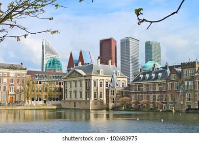 Binnenhof Palace - Dutch Parlament against the backdrop of modern buildings. Den Haag, Netherlands.