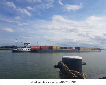 Binnenvaart, Translation: inland shipping cargo transport over the water river bij Volkerak lock, Netherlands August 2017