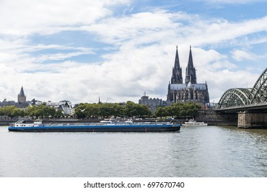 Binnenvaart, Translation: inland shipping cargo transport over the rhine river , Chemgas gas tanker on the rhein river by Cologne Koln Germany August 2017