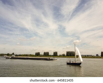 Binnenvaart, translation inland shipping ,inland shipping on the river moving cargo over the water Netherlands 2017