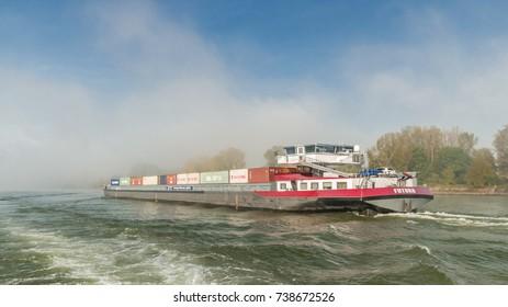 Binnenvaart, TRANSLATION: Inland shipping on the rhein river during a mist foggy morning by Nierstein Germany October 2017