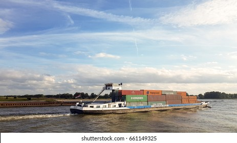 Binnenvaart, Translation, Inlandshipping container vessel transportation containers over the river in the Netherlands Waal River, June 2017
