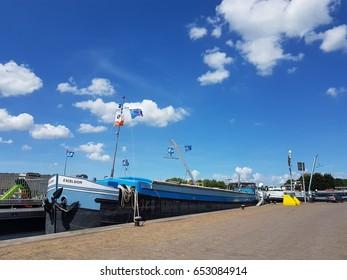binnenvaart, Translation Inlandshipping in the docks inland locks of the Harbor port Terneuzen Netherlands June 2017