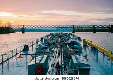 Binnenvaart, Translation Inlandshipping on the river rhein in Germany during sunset hours, Gas tanker vessel rhine river oil and gas transport Germany near Koblenz