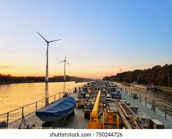 Binnenvaart, Translation Inlandshipping on the river canal Albert canal Antwerp during sunset hours, Antwerp Belgium November 2017
