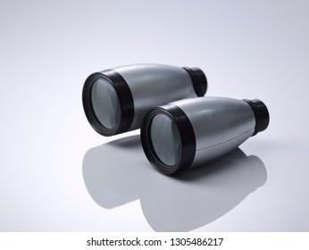 binocular on the white background with relflection