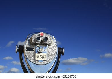 A binocular viewer looking out over blue sky.