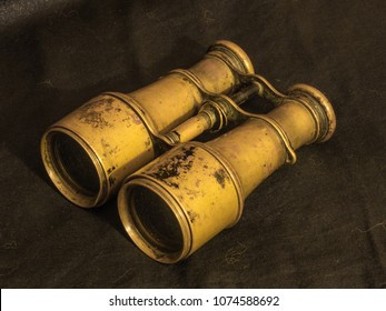 Binoculars belonged to a soldier of the World War I, who later was a member of the anti-Bolshevik army of Baron Wrangel in the Crimea. Yellow metal, black background.