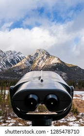 Binoculars looks out to colorful mountain vista