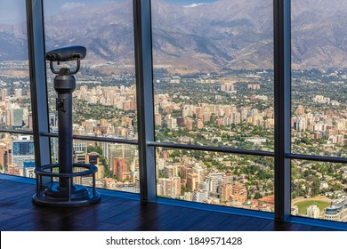 Binoculars on the viewing deck of South America's tallest building, with panoramic views, Gran Torre Santiago, or the Costanera Center Torre 2, a major tourist attraction, Santiago, Chile 12.21.17