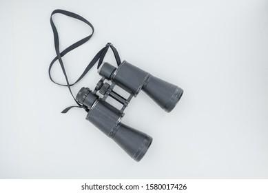 binoculars on a white background. antique binoculars. binoculars