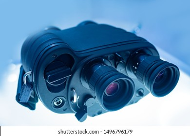 Binoculars with a range finder. Binoculars with night vision device. Observation from a distance. Advanced equipment for remote observation. Military Commune. Spy's equipment.Ammunition for the hunter