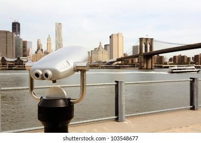 binoculars for sightseeing from Brooklyn towards Lower Manhattan in New York City