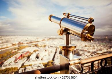 binoculars telescope and view on Paris