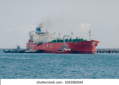 Bintan Island - March 2018 ; Tag boat guide a PERTAMINA LPG Tanker to the Jetty Near Tanjunguban, Bintan Island- Indonesia
