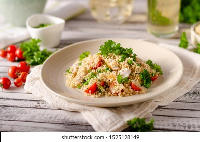 Bio couscous with chicken meat, tomatoes and fresh herbs