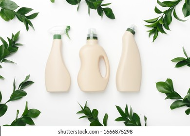 Bio organic detergent products for home cleaning and washing. Blank label bottles for mockup packaging of cleaning detergent on white background with green plants