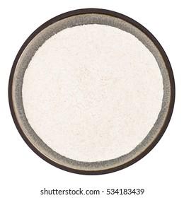 Bio organic locust bean gum powder in ceramic bowl isolated on white background, top view