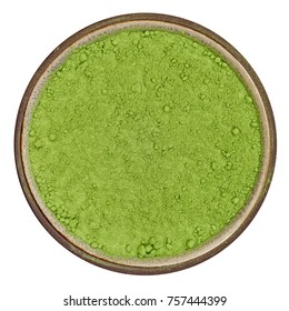 Bio organic wheatgrass powder in ceramic bowl isolated on white background, top view in natural light