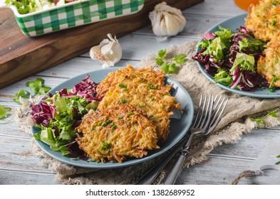 Bio potatoes fried with herbs and garlic, fresh salad and herbs