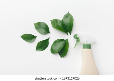 Bio spring cleaning. Eco spray bottle for safety cleaning, green leaves, white background