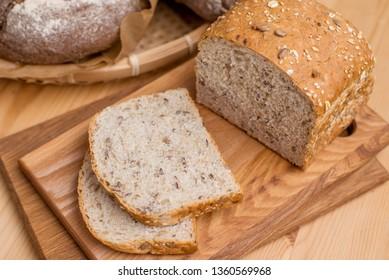 Bio whole grain homemade bread on wooden table