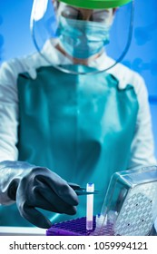 Biobanking. Technician preparing biological sample for deep freezing