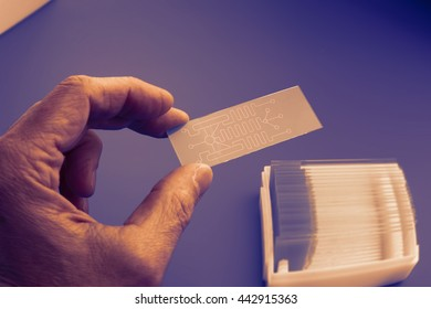 biochip for identifying proteins, Lab on Chip - systems all process for analysis of a sample are integrated into one glass plate.  Toned image