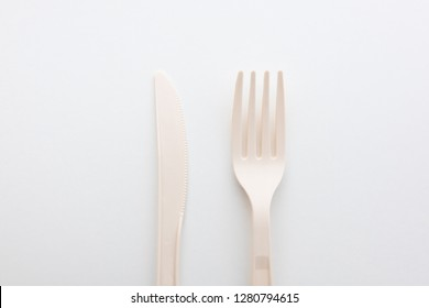 Biodegradable plastic spoon, fork and knife on white background isolate