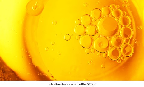 Biodiesel, bubbles biofuel, vegetable oil, yellow and orange emulsion bubbles background