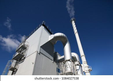 Biofuel boiler house on a blue sky background