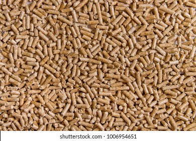 Biofuels. Alternative biofuel from sawdust. Wood pellets background. The cat litter.