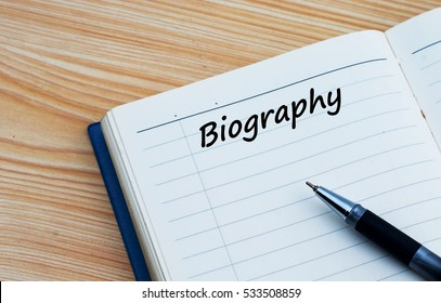 Biography text written on a businessman diary.