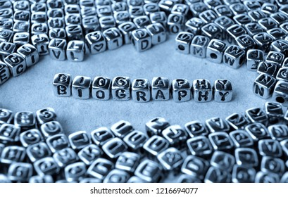 Biography - Word from Metal Blocks on Paper - Concept Photo on Table