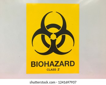 Biohazard sign on biosafety cabinet class 2 in medical laboratory.