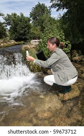 Biologist testing quality of water